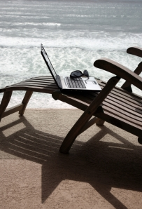 Beach chair, laptop, and sunglasses
