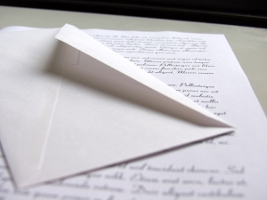 An open envelope sitting on top of a letter