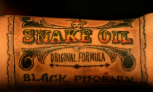 "Photo of a multi-colored tatoo that reads ""snake oil."""