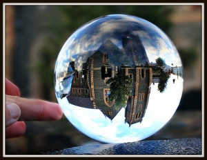Photo of a cathedral being reflected in a crystal ball