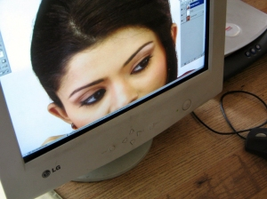 Photo of face on a computer screen