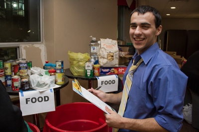 photo of volunteer at food and clothing drive