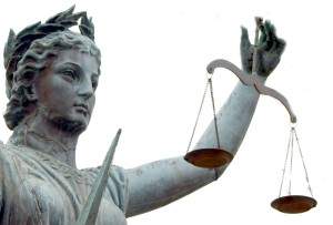 A statue of Justice holding scales in balance.