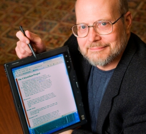 Photo of Ray Schroeder pointing to an iPad