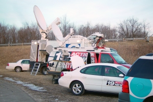 photo of news trucks with satellite feeds