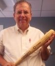 Photo of Russ Poulin with baseball bat