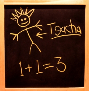 Blackboard with childish scrawl reading 1+1=3