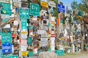 Wall of signs from many cities