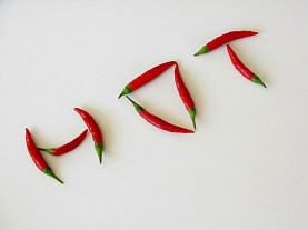 "Photo of jalapeno peepers arranged to spell the word ""hot"""