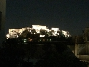 Photo of the Acropolis in Greece at night.
