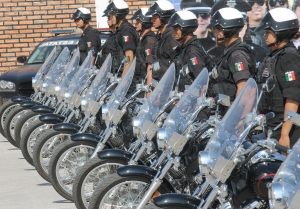 Photo of a line-up of  motorcycle police and their motorcycles.