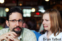 Photo of a man looking confused and a woman making a face of disbelief