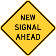 "Warning sign that reads: ""New Signal Ahead"""