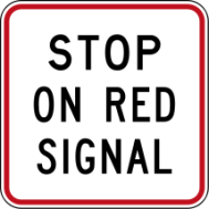 "Warning sign reading: ""Stop on Red Signal"""