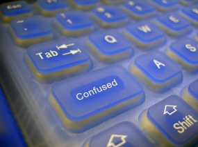 "Computer keyboard with the key under the ""tab"" key labeled as ""confused."""