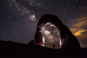 arch rock, climber and stars