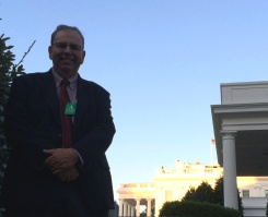 Russ Poulin with a side view of the White House