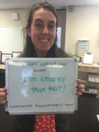 "Woman holding white board saying ""I don't contract cheat because I'm smarter than that!"""