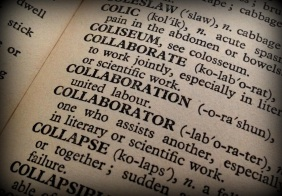 Close up of a dictionary entry for collaborate (to work jointly, especially in literary or scientific work), collaboration (united labour), and collaborator (one who assists another).