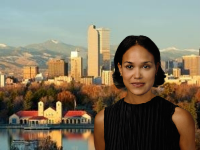 Young woman standing in front of a city landscape.