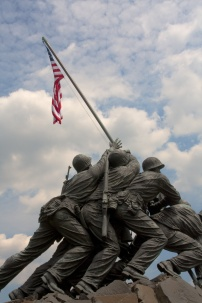 Iwo Jima statue of marines raising a flag on the top of a mountain.