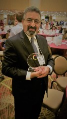 Dr. Vadiee holding Digital Inclusion Award