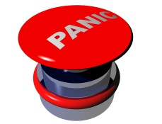 "A red button with the word ""panic"" on it"