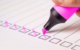 A list of checkboxes being checked with a pink highlighter pen