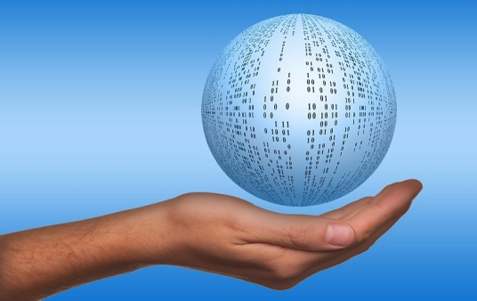 """hand holding a graphic of a """"ball of data"""""""