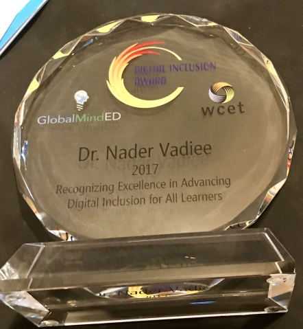 "Glass plaque for the 2017 award winner Dr. Nader Vadiee. Plaque reads ""recognizing excellence in advancing digital inclusion for all learners."""