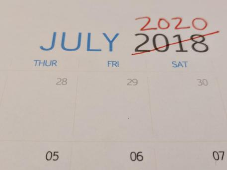 jULY 2018 Calendar with 2018 crossed out and 2020 written in