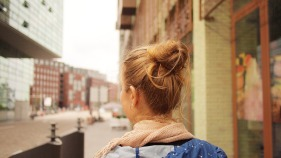A young female looking around a city