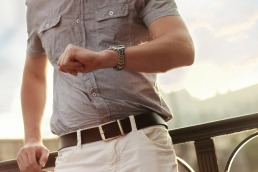 a man waiting and looking at his watch