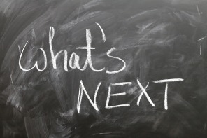 "A chalkboard that reads ""what's next"" in chalk"