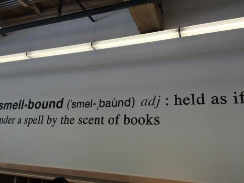 "Photo of a wall with the words ""smellboud adj: held as if under a spell by the scent of books"""