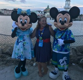 Cali poses with Mickey and Minnie