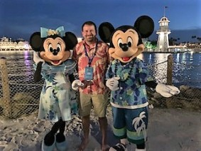 luke poses with Mickey and Minnie