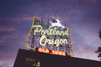 Old Town neon sign in Portland with the deer jumping over the words portland oregon