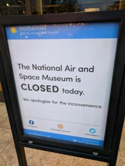 """Picture from sign posted at the Smithsonian National Air and Space Museum. The signs read """"The National Air and Space Museum is Closed today."""""""