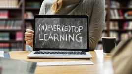 """Picture of a laptop computer screen that reads, """"Never Stop Learning."""""""