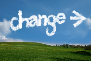 Change written in the sky in while letters over green grass