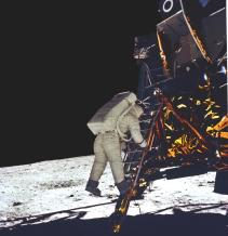 Astronaut astronaut Buzz Aldrin takes his first step onto the surface of the Moon.
