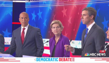Senators Booker and Warren watch Beto O'Rourke at one of the 2019 democratic debates