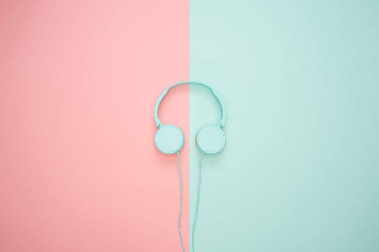 image of headphones on a pink and green background