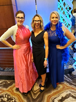 Lindsey, Megan, and Tanya dressed up in long formal dresses for the awards show