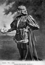 black and white photo of a woman holding a skull, portraying Hamlet