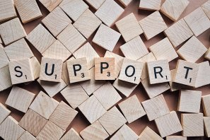 """scrabble tiles (wooden blocks) used to spell the word """"support"""""""