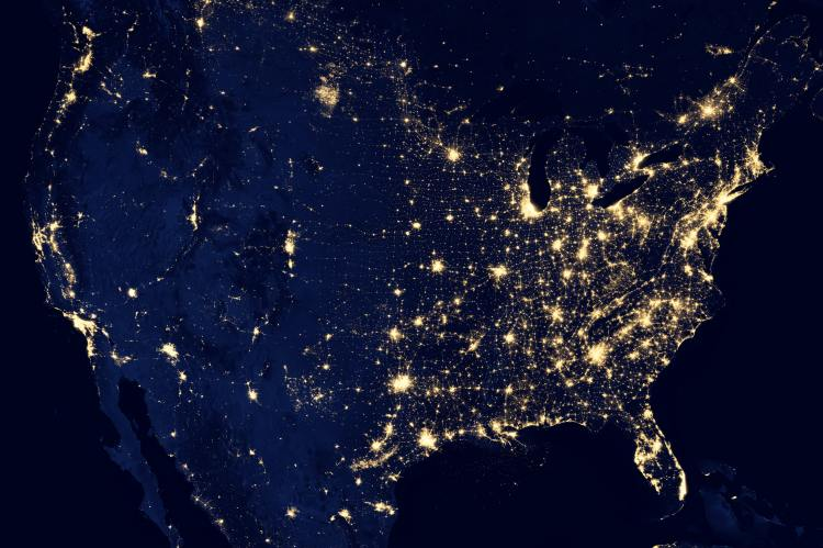 Photo of the united states in the dark with lights showing heavy populated areas