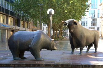 metal statures of a bull and a bear in a courtyard