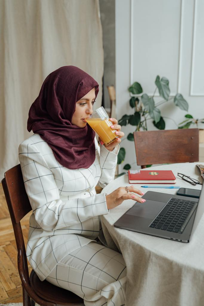 woman in a hijab on a laptop